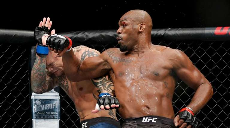 Jon Jones, right, fights Anthony Smith in a