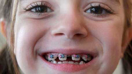 Madison Petrusa, 7, of Commack, shows off her