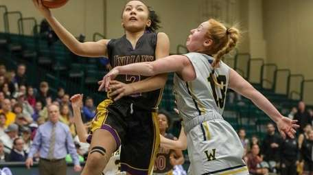 Nia Lariosa #2 of Sewanhaka goes up for