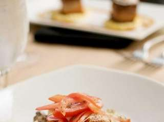 Seared sea scallops are served with wild mushroom