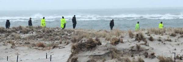Police search Cedar Beach on April 5, 2011.
