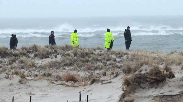 Police search Cedar Beach on April 5, 2011.