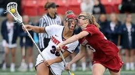 Stony Brook's Sabrina Tabasso (36) collides with Stanford's