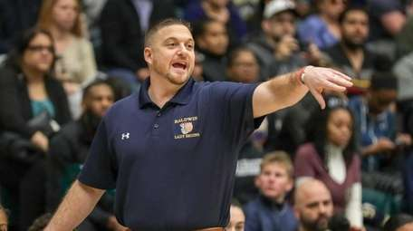 Head Coach Tom Catapano of Baldwin directs his