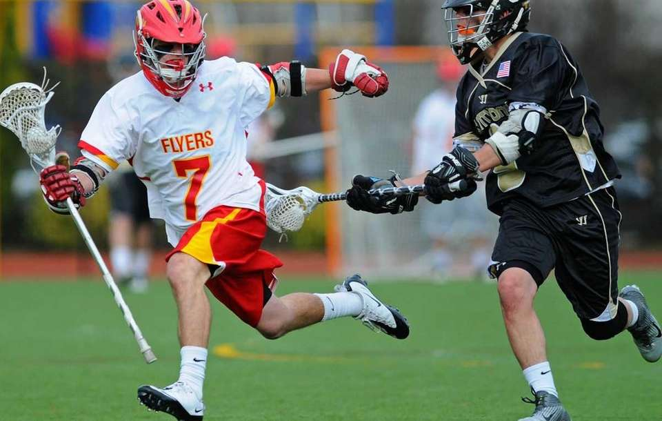 Chaminade High School midfielder #7 Walter Rooney, left,