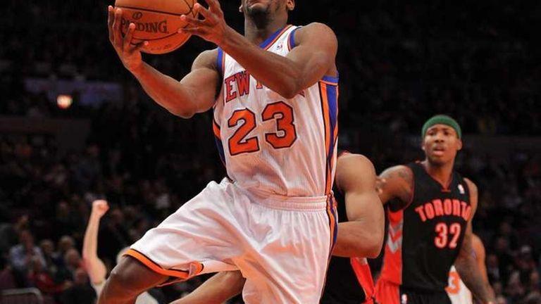 New York Knicks guard Toney Douglas (23) drives