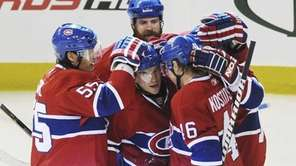 Montreal Canadiens' Michael Cammalleri celebrates with teammates Brent