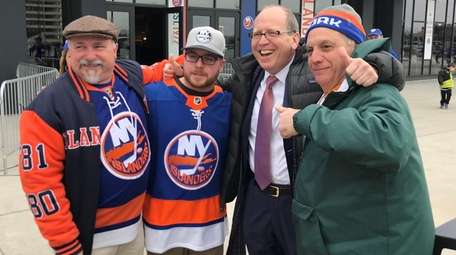 Islanders co-owner John Ledecky, second from right, with