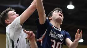John Mastando #30 of Manhasset, right, drives to