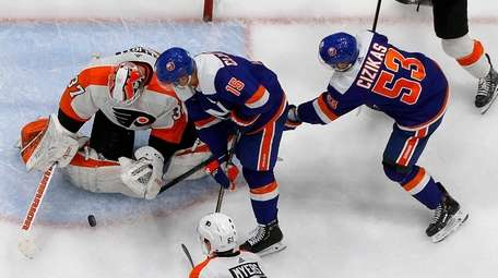 Cal Clutterbuck #15 and Casey Cizikas #53 of