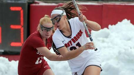 Stony Brook's Taryn Ohlmiller  drives from behind