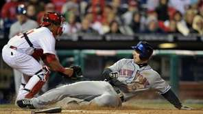 The Mets' David Wright slides into home past