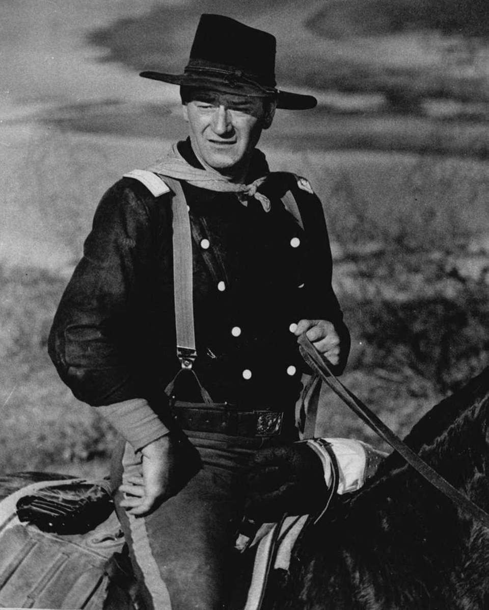 Union cavalry led by John Wayne slashes deep