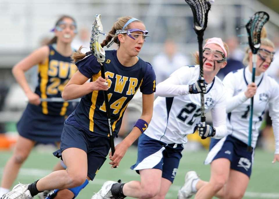 Shoreham's Corinne Wiederkehr (14) drives while defended by