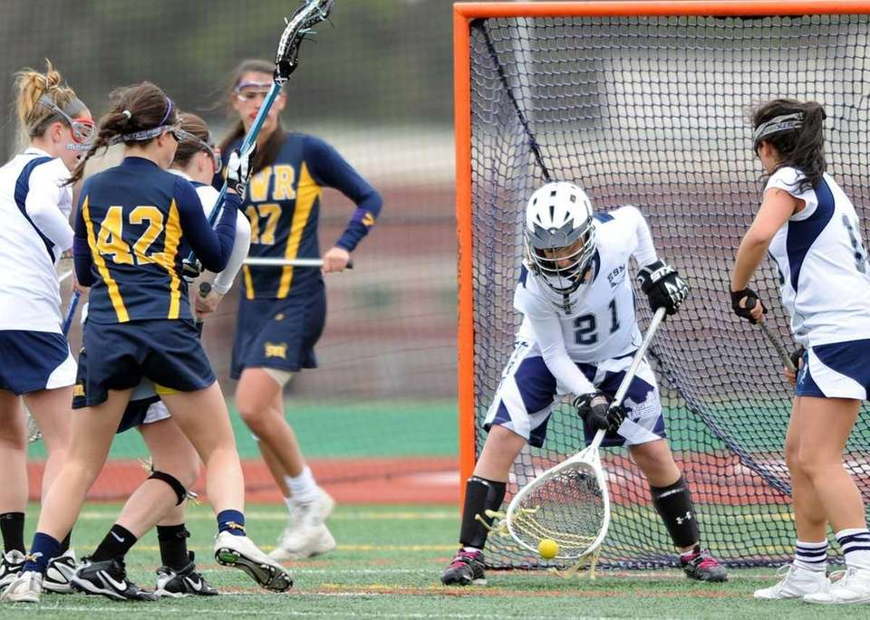 Eastport's Goalie Sam Giacolone (21) makes the save