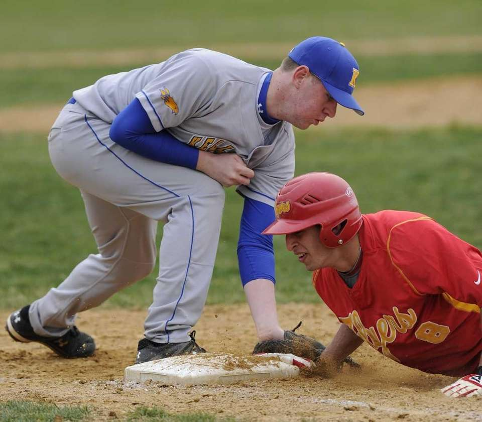 Chaminade's Michael Ferranti is safe at first on