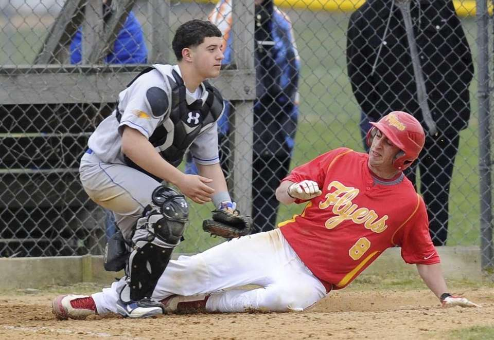 Chaminade's Michael Ferranti scores as Kellenberg's catcher waits