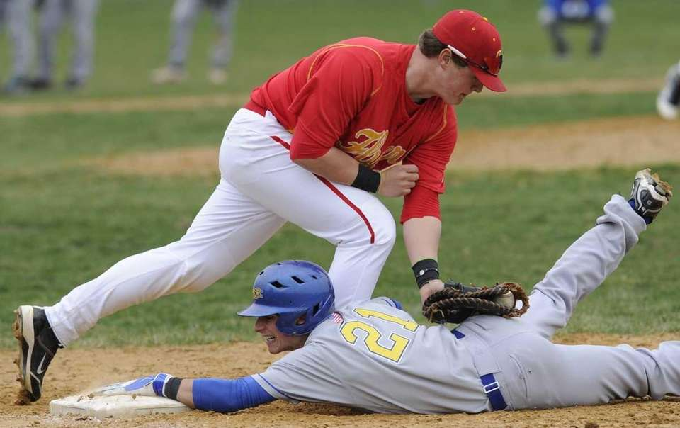 Kellenberg's Michael Palladino is safe at first ahead
