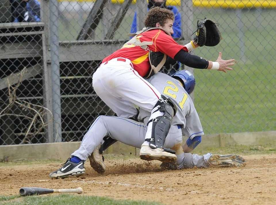 Kellenberg's Michael Palladino slides safely home as Chaminade's