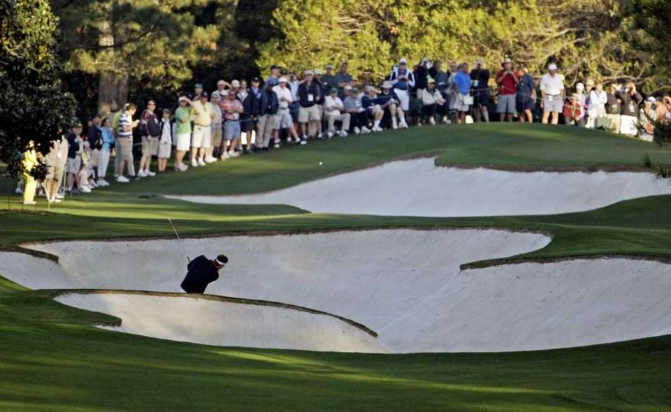 Jeff Overton hits out of a bunker on