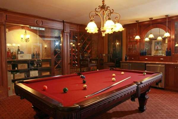 The combination wine room-pool room at a home