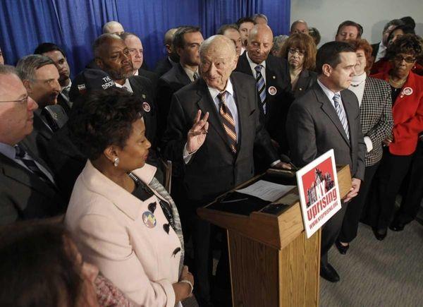 Former New York Mayor Ed Koch, center, joined