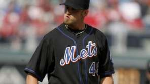New York Mets starting pitcher Jonathon Niese looks