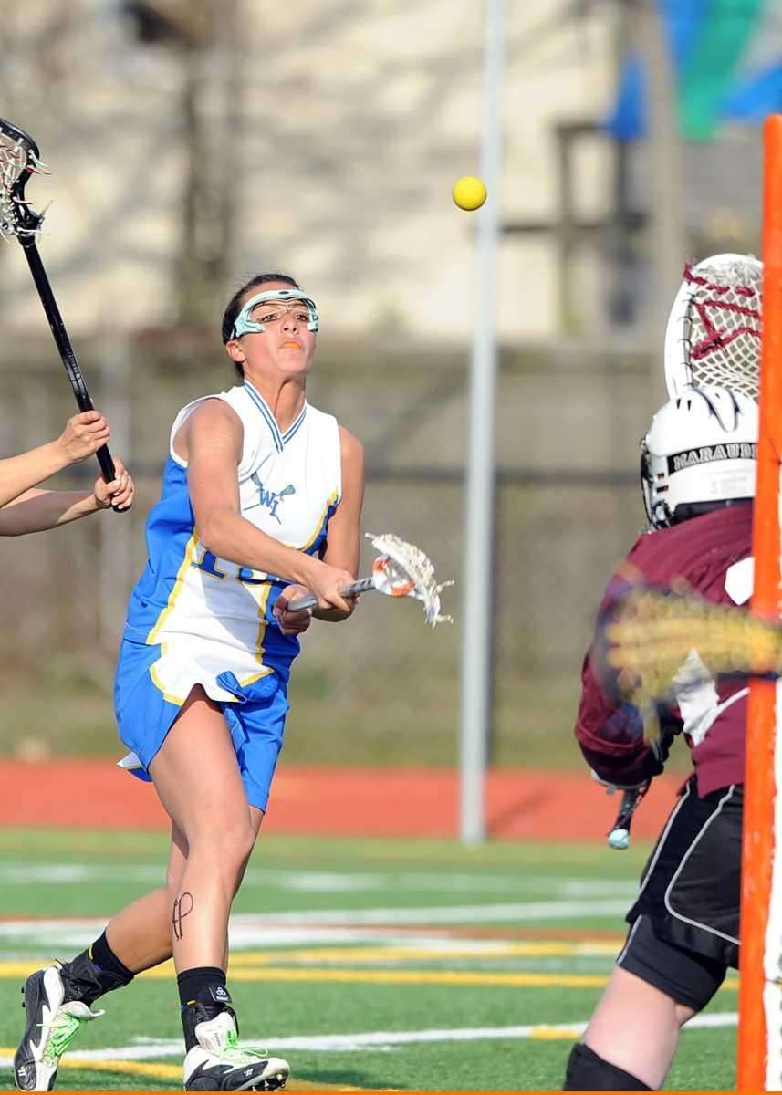 West Islip's Loren Ziegler (15) shoots on goal.