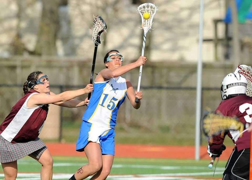 West Islip's Loren Ziegler (15) beats Bay Shore's