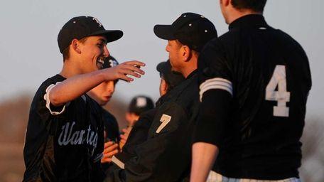 Wantagh High School pitcher #15 Shaun Milito, left,
