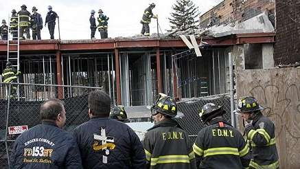 In this Feb 12, 2009 photo, firefighters examine