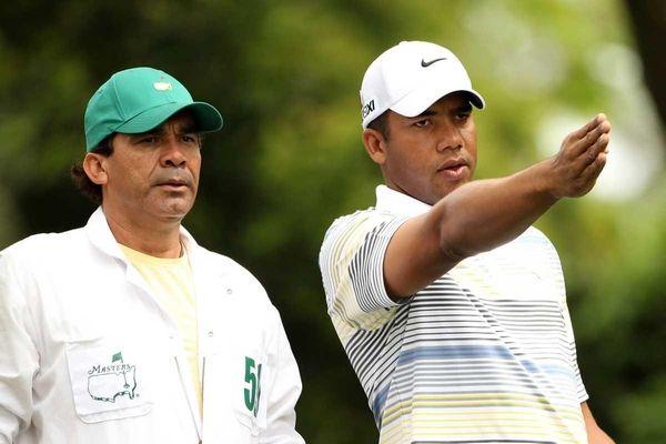 Jhonattan Vegas of Venezuela talks with his caddie