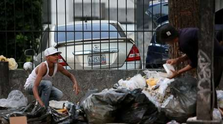 People look for food in the garbage due