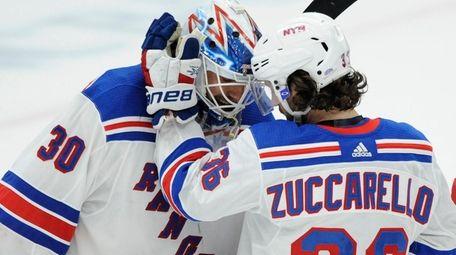 Rangers goalie Henrik Lundqvist is congratulated by Mats