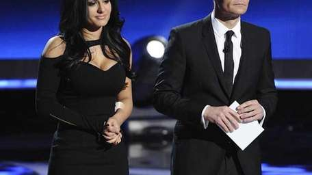 Pia Toscano, with Ryan Seacrest, is eliminated from