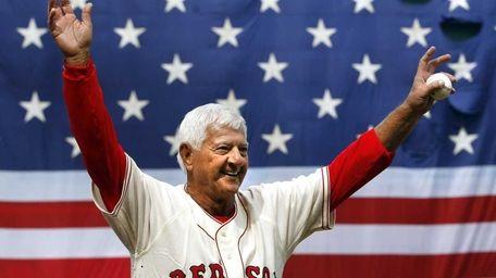 Former Boston Red Sox great Carl Yastrzemski waves