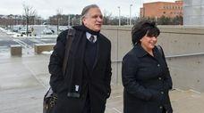 Edward and Linda Mangano arrive at federal court
