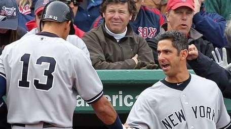 Alex Rodriguez celebrates with Jorge Posada after hitting