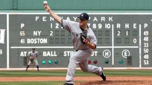 Yankees starter Phil Hughes throws against the Red