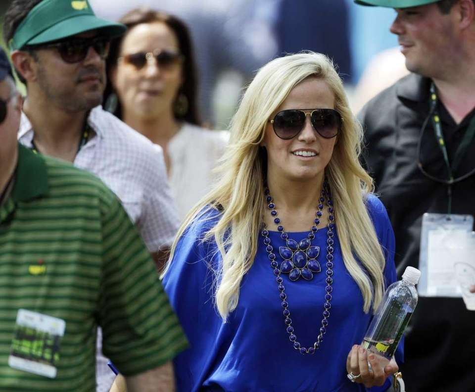 Phil Mickelson's wife Amy walks with spectators down