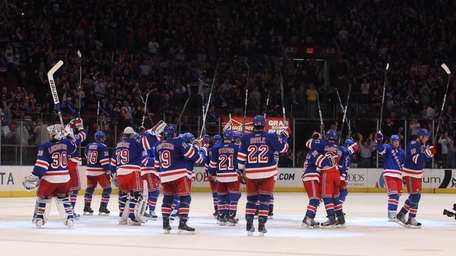 The Rangers celebrate their 5-2 win over the