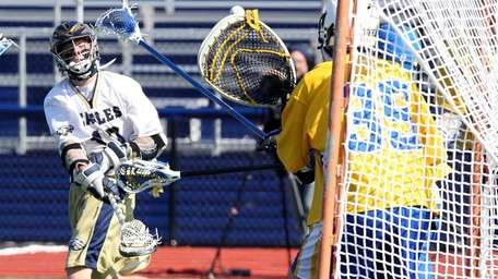 Bethpage's Tom Engelhardt scores against Lawrence goalie Brandon