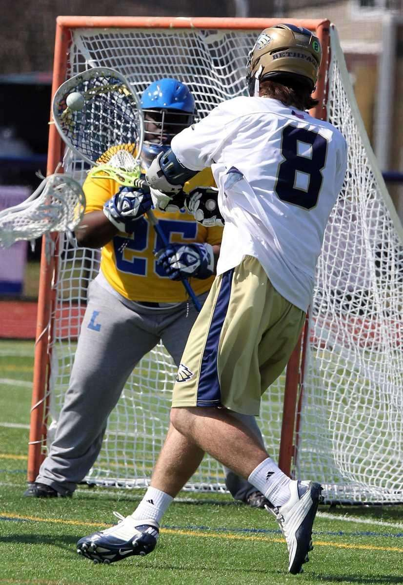Bethpage's Ryan Mahon (8) scores against Lawrence goalie