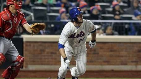 Ike Davis of the Mets hits a two-run