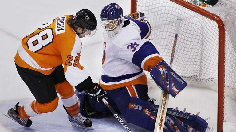 The Islanders' Rick DiPietro stretches across the width