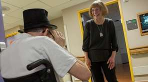 Care monitor Lois Byalick meets with a client