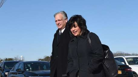 Edward and Linda Mangano arrive at federal court