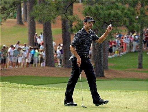 Charl Schwartzel of South Africa holds up his
