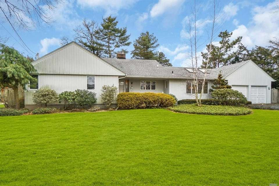 This Massapequa ranch includes three bedrooms and two