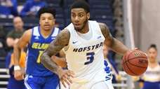 Hofstra guard Justin Wright-Foreman dribbles the ball up